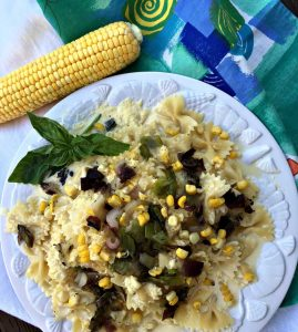 Enjoy corn pureed and used as a sauce over pasta dressed with fresh summer vegetables.