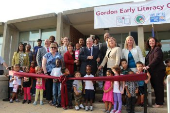 The Gordon Early Literacy Center celebrates its grand opening with a ribbon cutting ceremony.