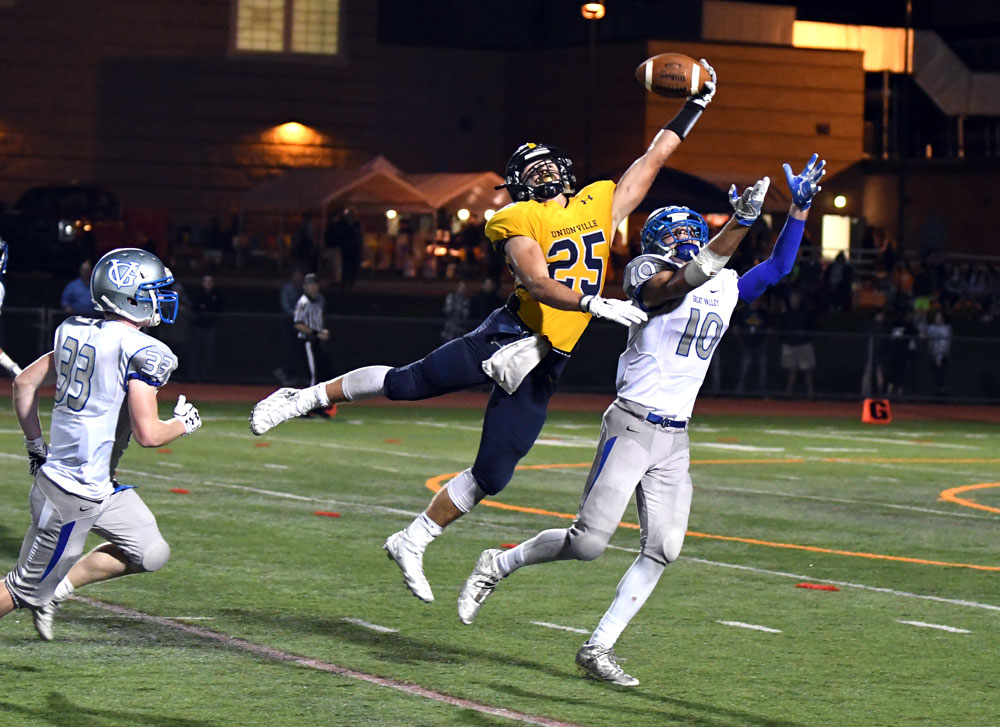 Unionville's Jack Adams makes a crucial one-handed catch over Great Valley's Brendan O'Donnell. Alex Castina Photo.