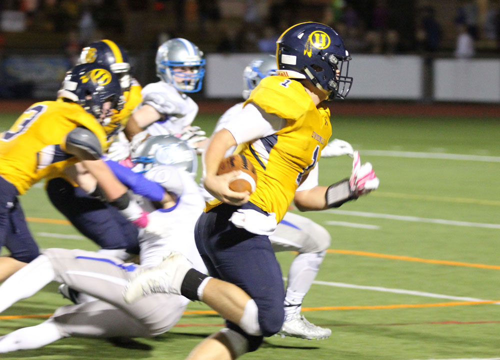 Unionville's Joe Zubillaga finds running room to the right on what would be the winning touchdown with less than a minute to go. Jim Gill photo.