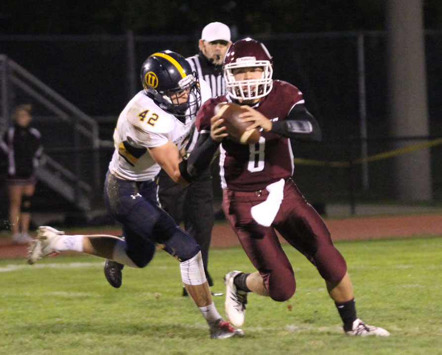 Unionville's James Watson closes in on Oxford quarterback Chandler England. Jim Gill photo.
