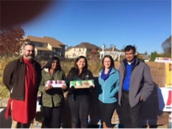 Pictured are Zachary Ruff, Dean of STEM Academy; Manasvi Pannala, volunteer; Sana Tipnis, volunteer; Kate Miller, Nutrition Services Manager at Kennett Food Cupboard; and Pannala Reddy, major donor for the Diwali Food Drive at Eagle Village.